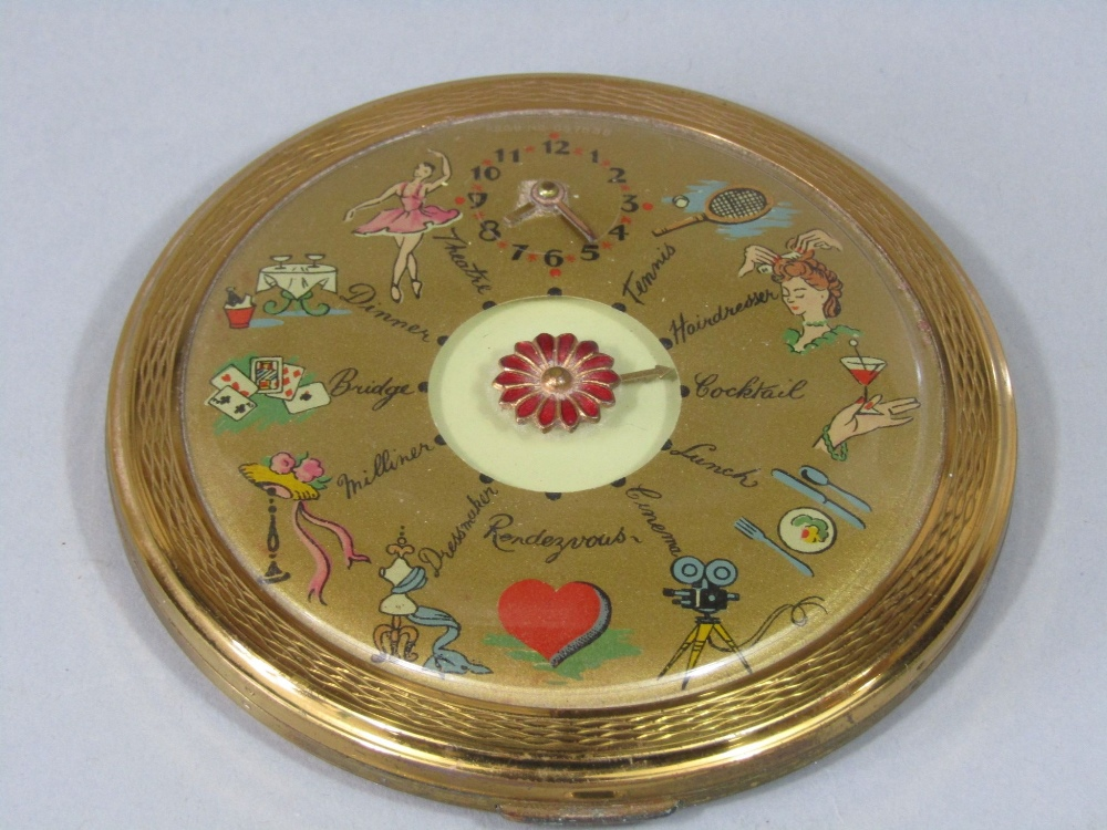 Lot 853 - A 1950s compact of circular form with pointer detailing events, tennis, hairdresser, cocktail lunch,