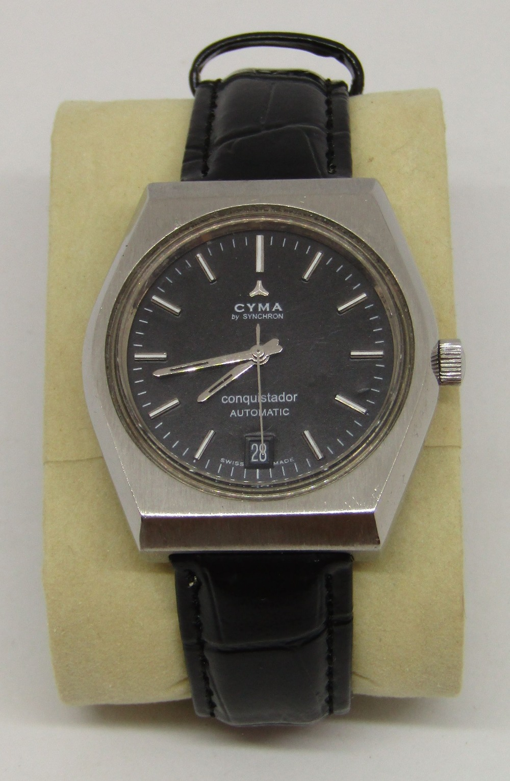 Lot 710 - Gents Cyma by Syncron Conquistador automatic gents stainless steel wristwatch, the black dial with