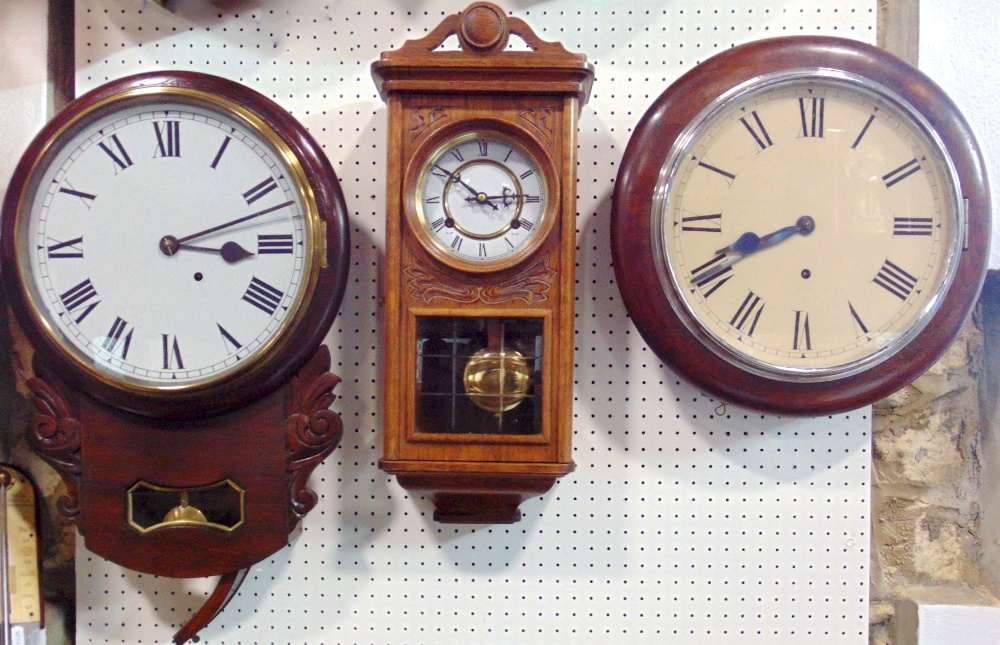 Lot 568 - A collection of wall timepieces to include a single train drop dial wall clock, a further single