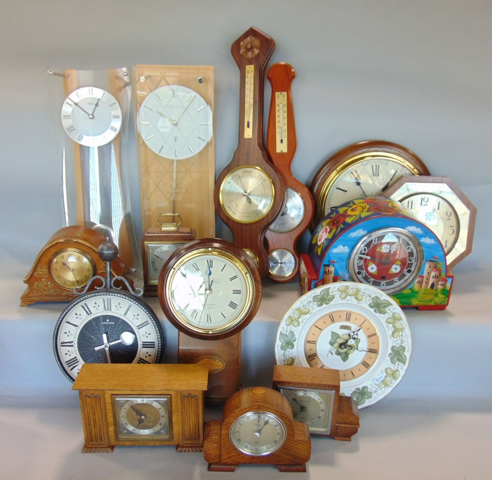 Lot 591 - A large collection of horology to include barometers, wall clocks, mantel clocks, etc