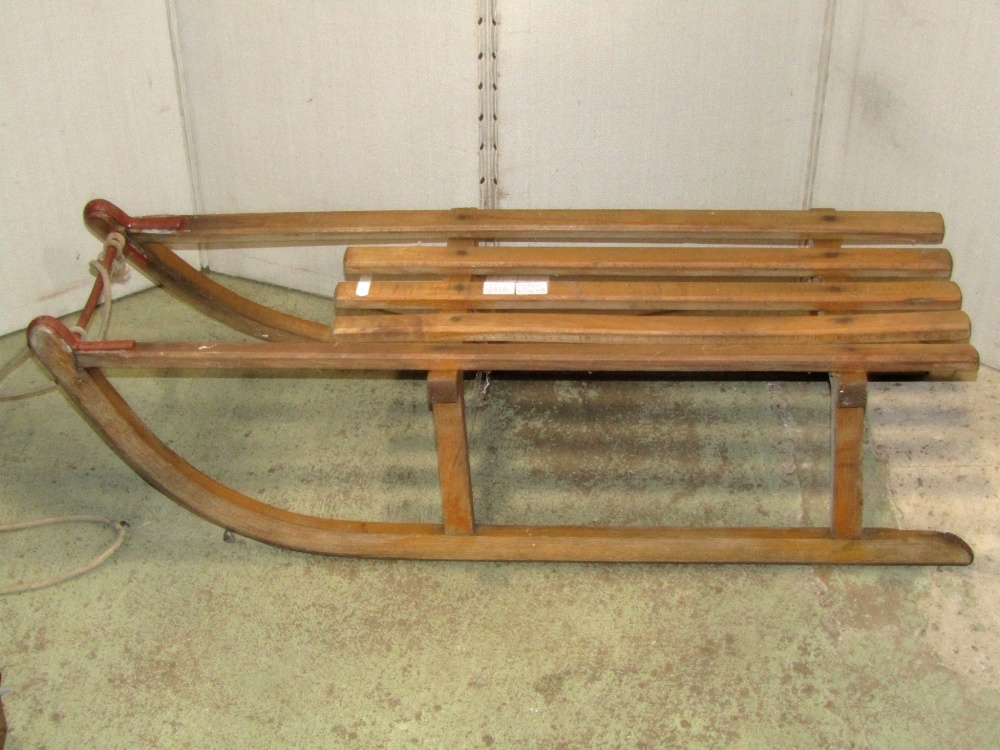 Lot 1243A - A sledge and a wine rack for 63 bottles