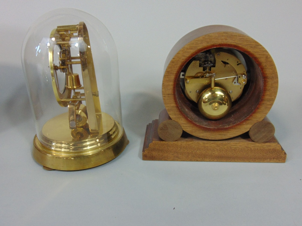 Lot 592 - A collection of various mantel clocks to include torsion examples, Commeti, Smiths and others (8)