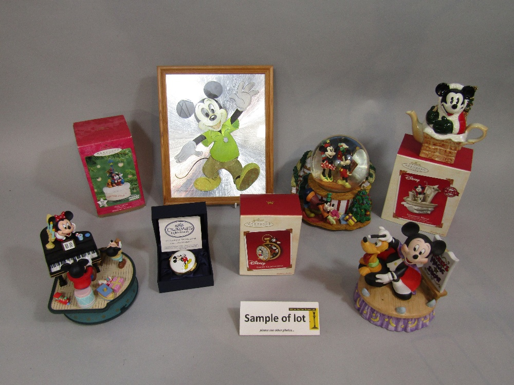 Lot 307 - A quantity of Disney related items including a musical snow globe, further musical groups, Christmas