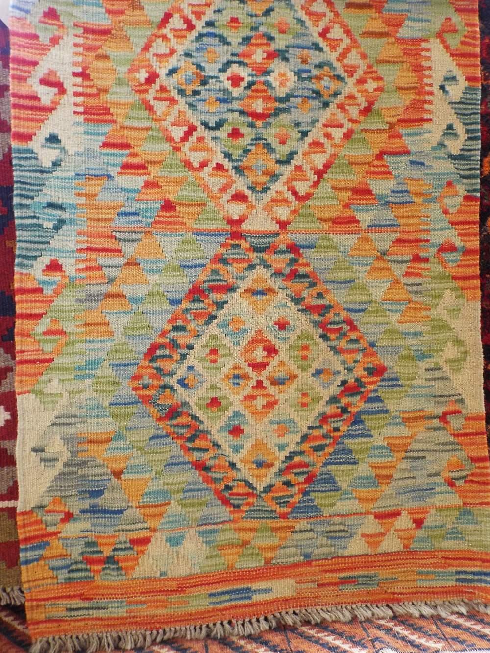Lot 1430 - Vegetable dye wool Choli Kelim runner, 202 x 70cm