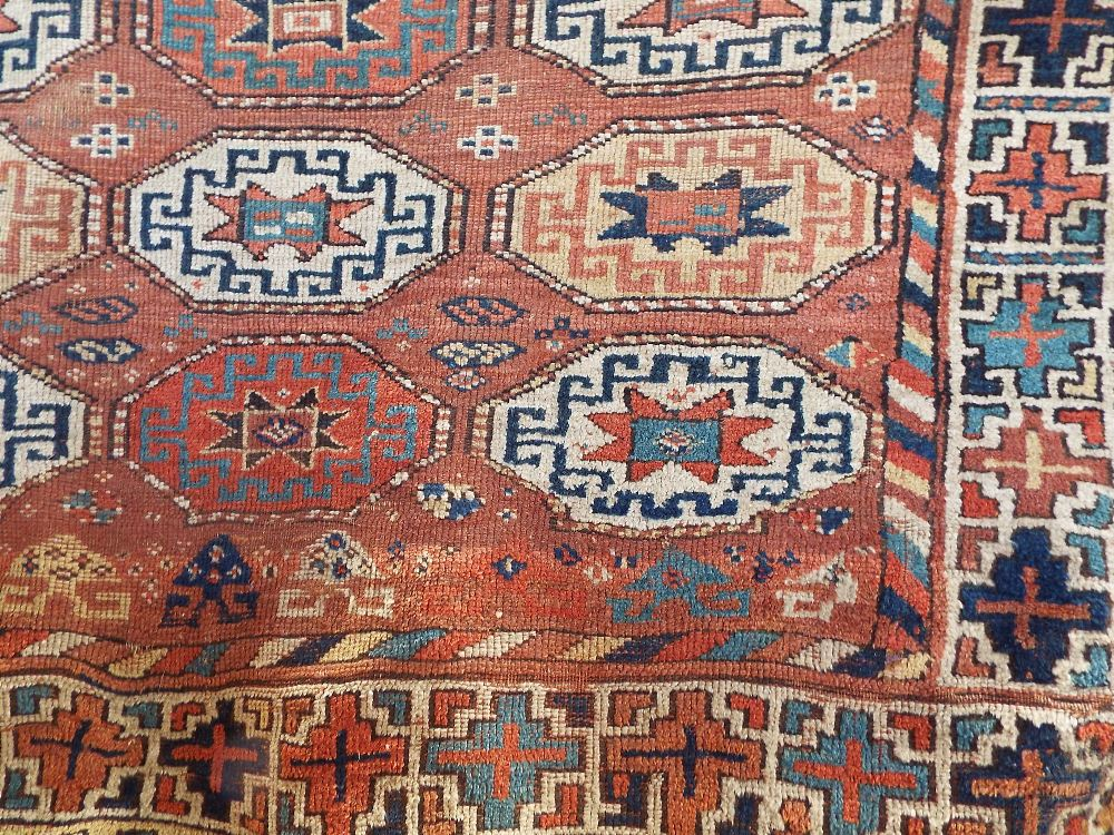 Lot 1416 - Old Kurdish type rug with geometric medallions upon a fawn ground, 250 x 140 cm