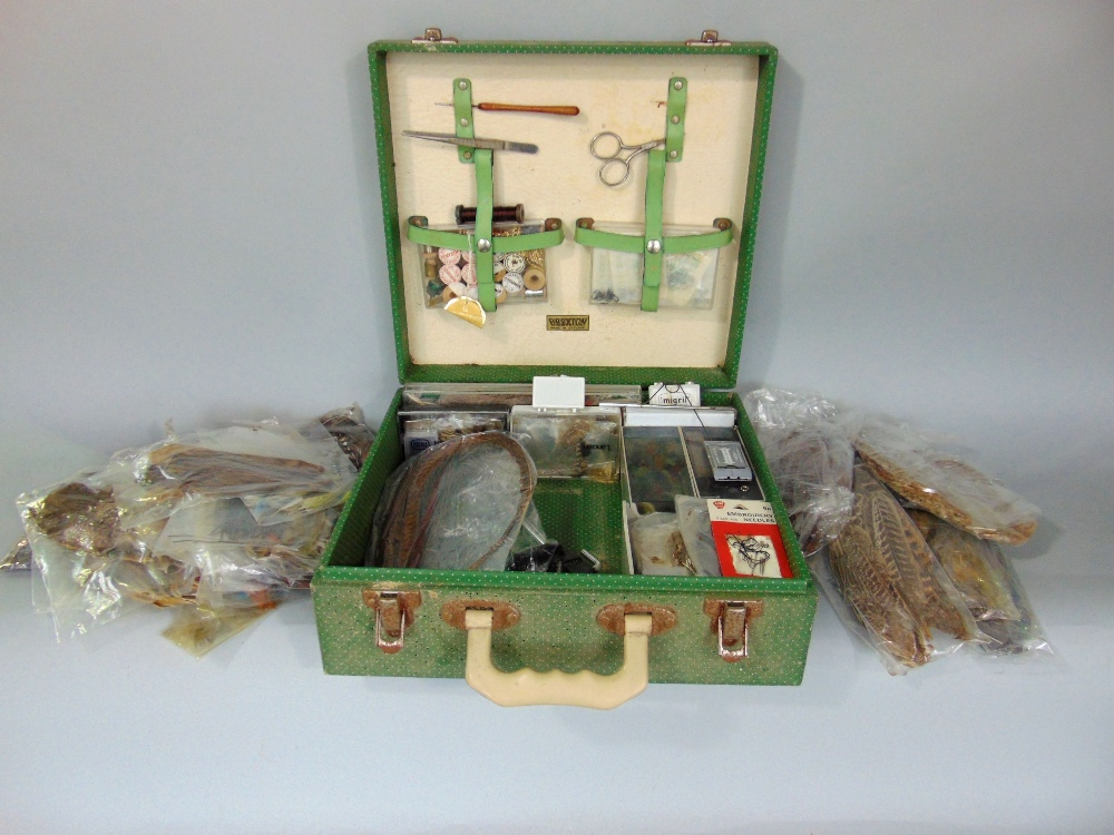 Lot 754 - A vintage Brexton picnic hamper containing fishing equipment for fly making including shoulders of