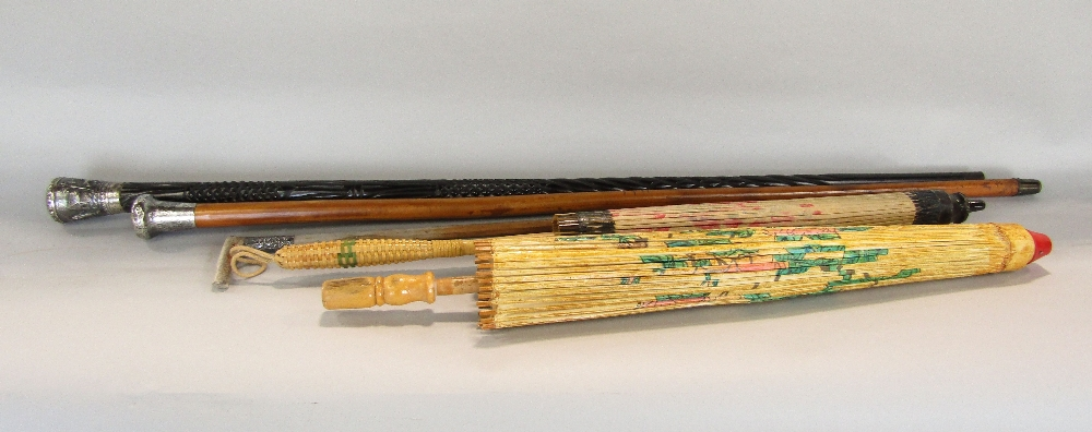 Lot 683 - A Malacca cane with engraved silver mount, a further ebony walking stick with embossed Indian silver