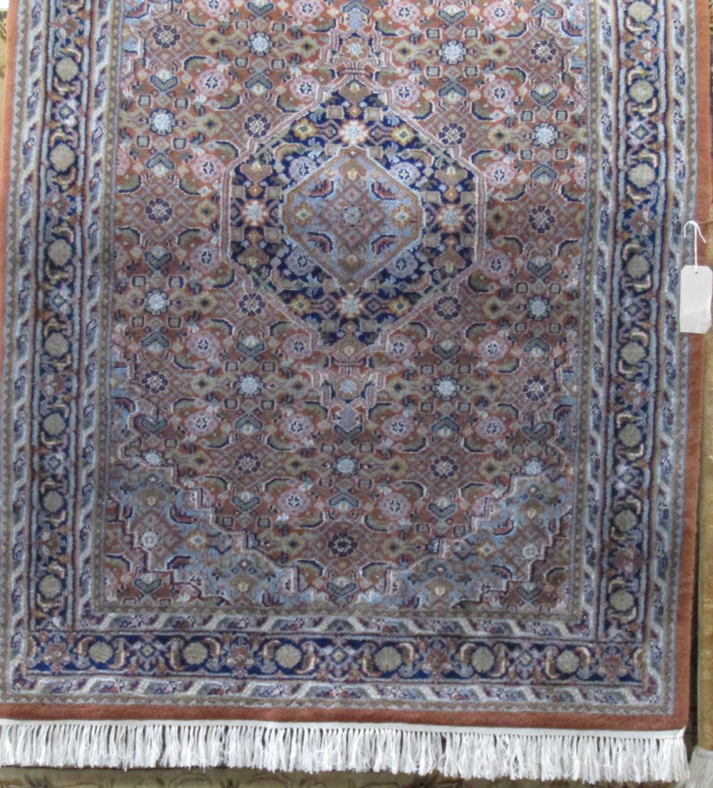 Lot 1417 - Persian full pile rug with central navy blue medallion and intricate geometric decoration, upon a