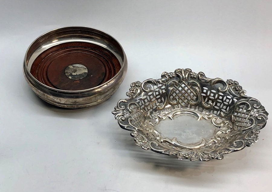 Lot 22 - Silver sweet dish and silver bottle coaster both full silver hallmarks , coaster measures approx 14c