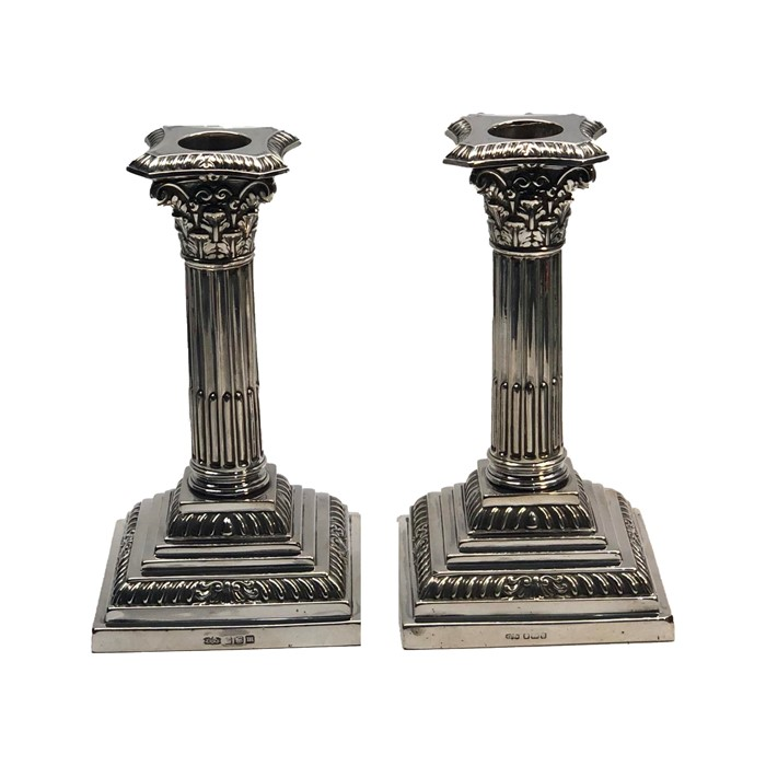 Lot 13 - Pair of Antique Sheffield silver corinthian column candlesticks by james dixon & sons height 16cm