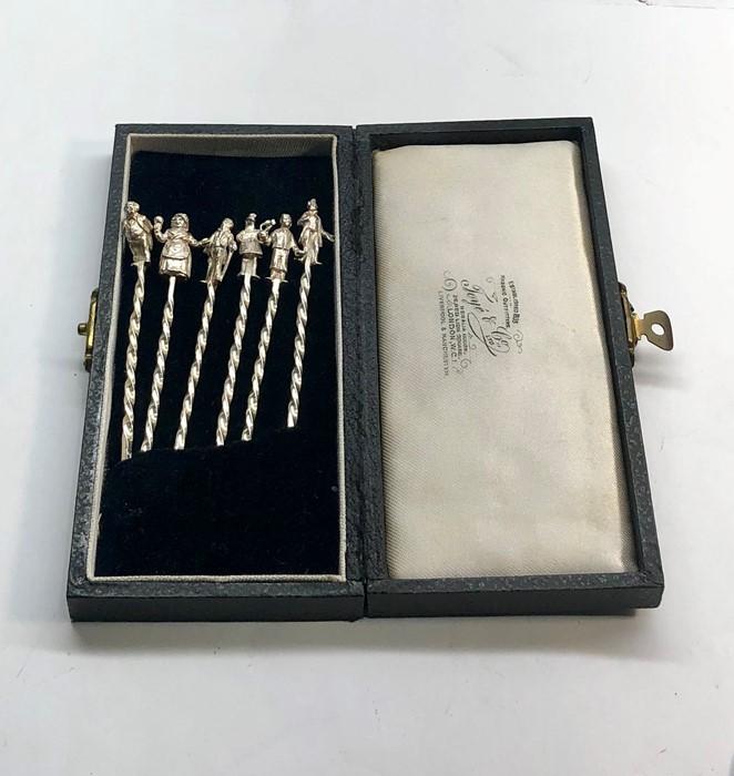 Lot 37 - 6 Hallmarked silver dickens cocktail sticks