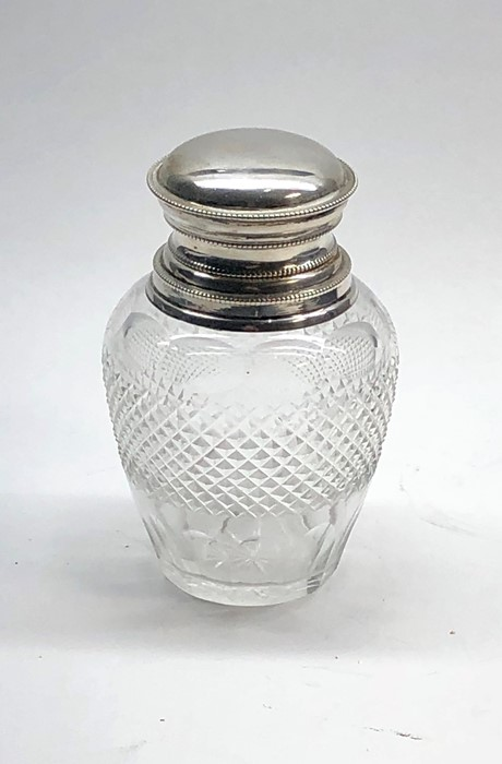 Lot 16 - Continental silver top tea caddy cut glass bottle with silver top not hallmarked but acid tested as