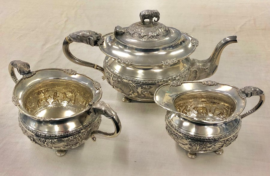 Lot 19 - Fine Siver Indian three piece teaset elephant handles embossed scenes .Krishniah Chetty and Sons we