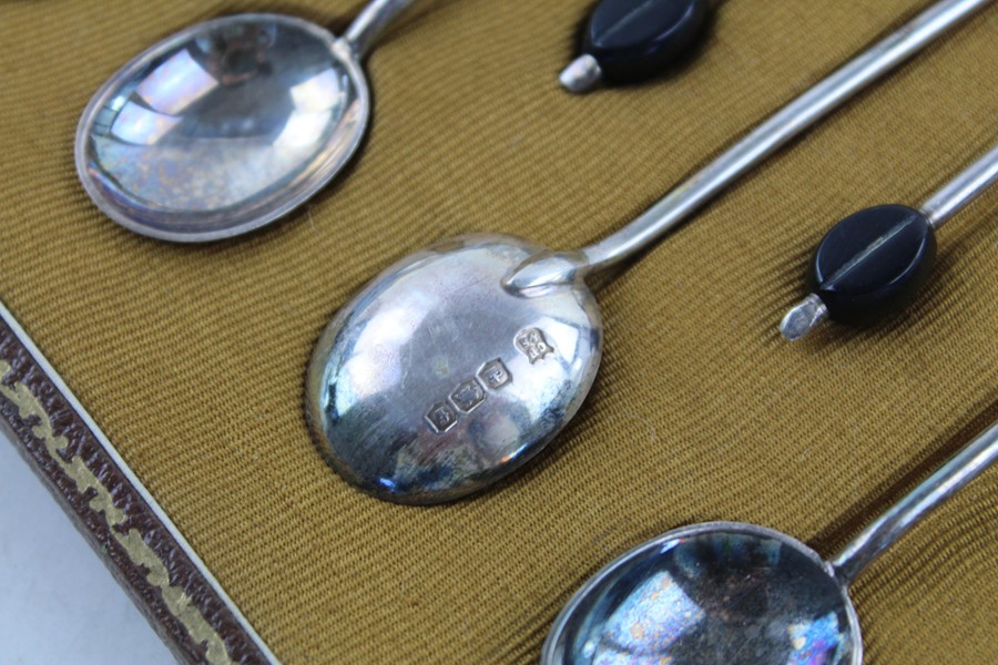 Lot 55 - 12 Vintage hallmarked 1923 925 silver coffee bean spoons with case maker Cooper Brothers & Sons appr