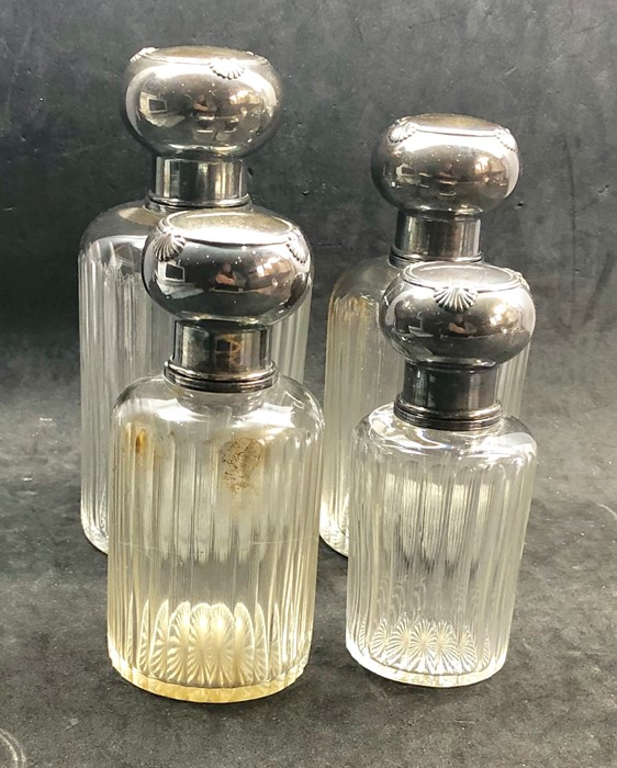 Lot 6 - A Fine set of 4 antique french hallmarked silver graduated scent bottles all complete with stoppers