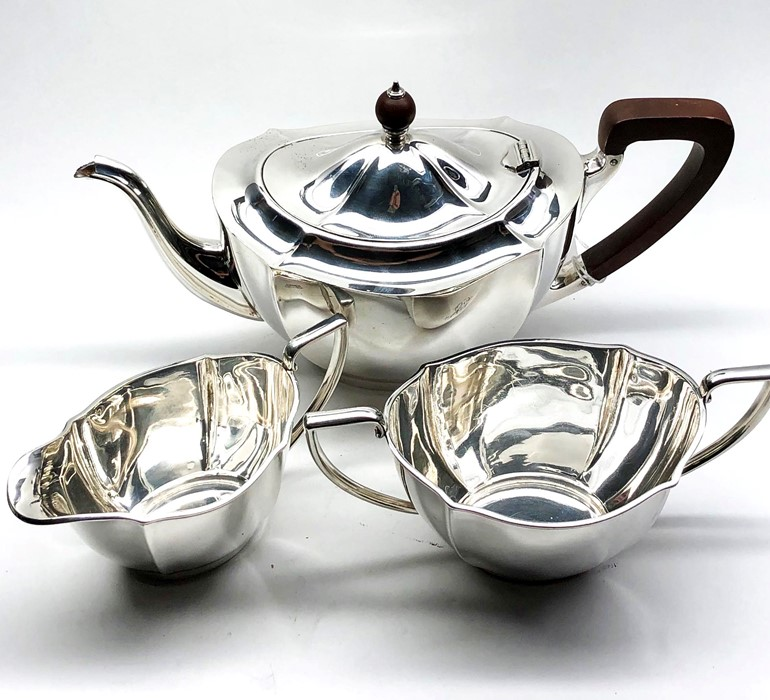 Lot 31 - three piece silver tea service Birmingham silver hallmarks weight 1083g