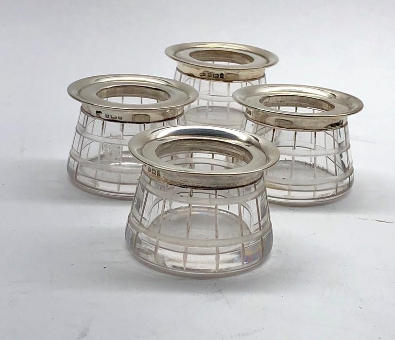 Lot 17 - 4 Silver and cut glass salt pts each with silver rim Birmingham silver hallmarks