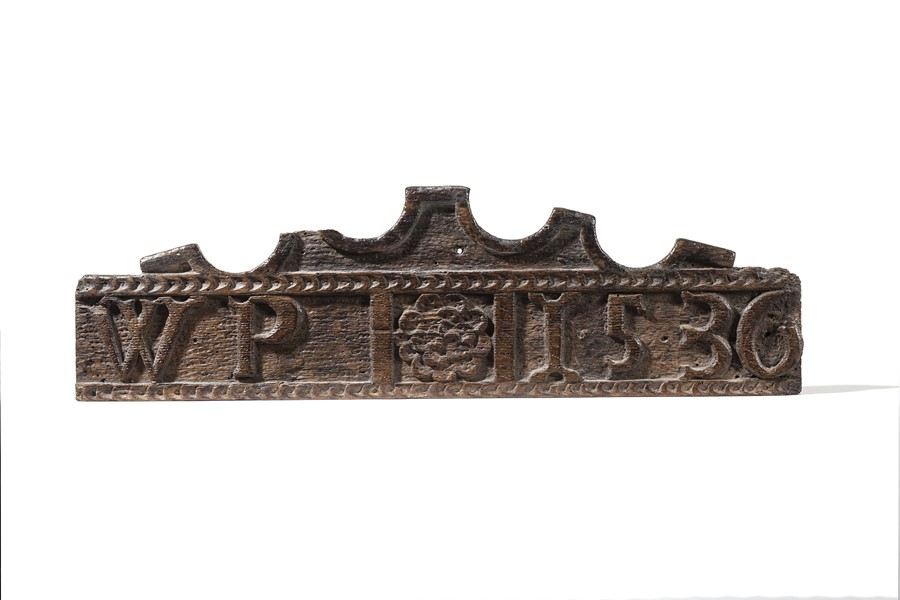 Lot 18 - A carved panel or crest, initialled and dated WP 1536