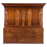 Lot 21 - A large George III oak housekeeper's cupboard, circa 1780