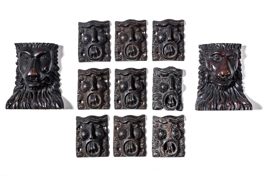 Lot 19 - A pair of carved lion heads, 19th century and nine other heads
