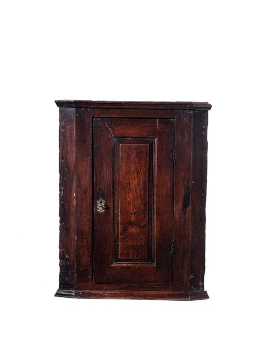 Lot 53 - A George II oak hanging corner cupboard, possibly Welsh, circa 1740
