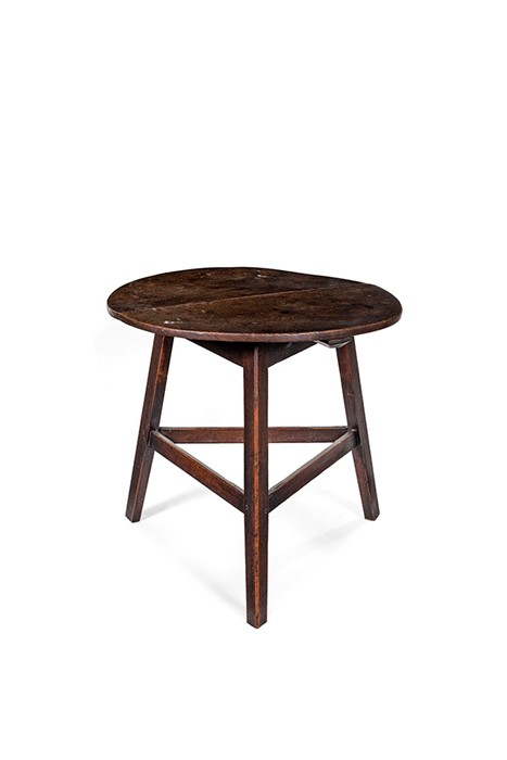 Lot 38 - A George III oak and elm cricket table, circa 1780