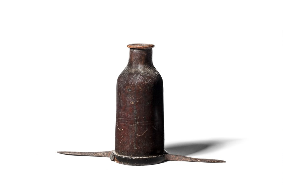 Lot 12 - A leather bottle cover, open to the base and with iron prongs, 18th / 19th century
