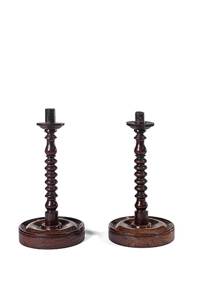 Lot 9 - A pair of George III rosewood candlesticks, circa 1780