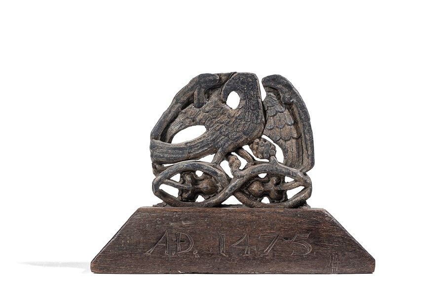 Lot 24 - A lead figure of an eagle mounted on an oak stand carved AD 1475