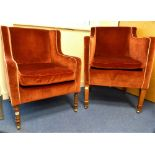 Lot 331 - Two early 19th century rectangular tub armchairs upholstered to match, one on ring turned mahogany