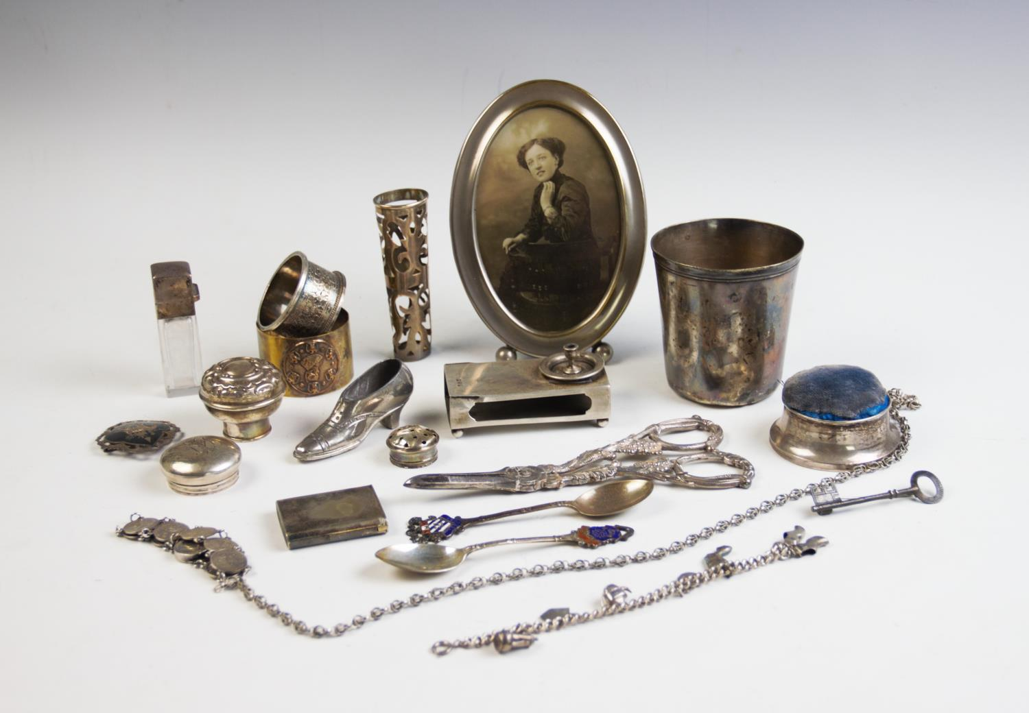 Lot 5 - A selection of silver and silver coloured wares, to include; a Chester silver match sleeve, a