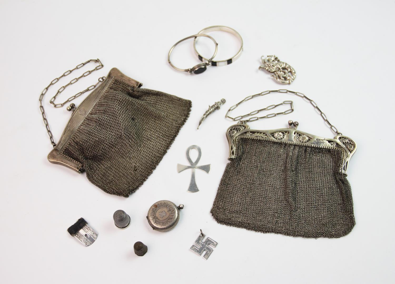 Lot 23 - A selection of silver and silver plated items, to include a white metal bangle set with mother of