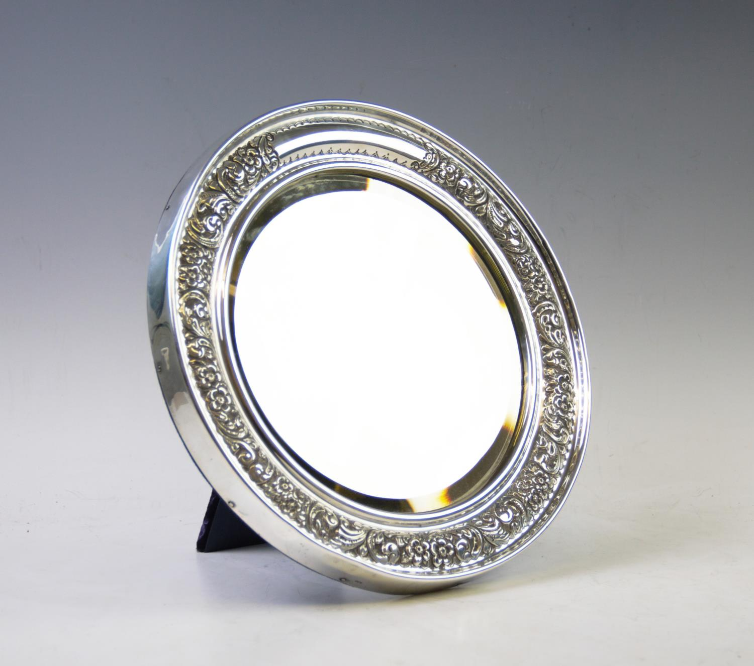 Lot 8 - A Victorian silver mirror, probably William Davenport, Birmingham 1900, of circular form, with