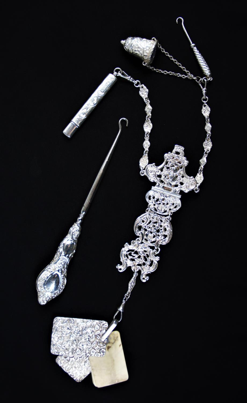 Lot 9 - A Victorian silver chatelaine, Cornelius Desormeaux Saunders & James Francis Hollings Shepherd,