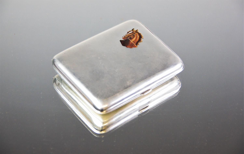 Lot 11 - Equestrian Interest: A continental silver and enamel cigarette case, circa 1920, of rectangular form