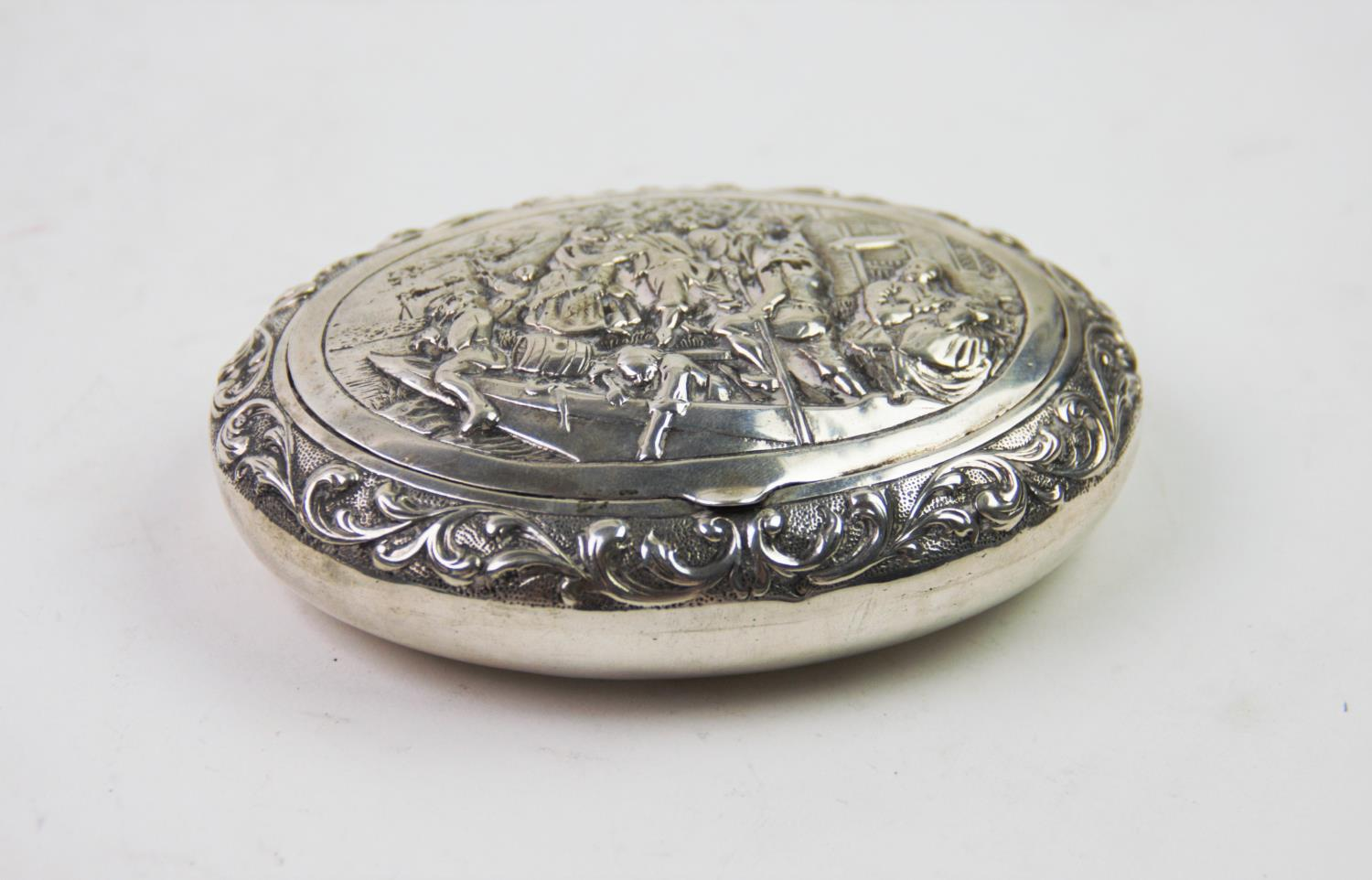 Lot 37 - A 19th century Dutch silver snuff box, of oval form, the cover decorated with embossed figures on