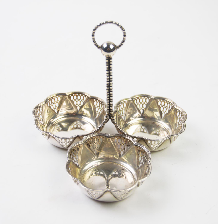 Lot 58 - An Edwardian silver centrepiece, Synyer & Beddoes, Birmingham 1913, designed as three pierced