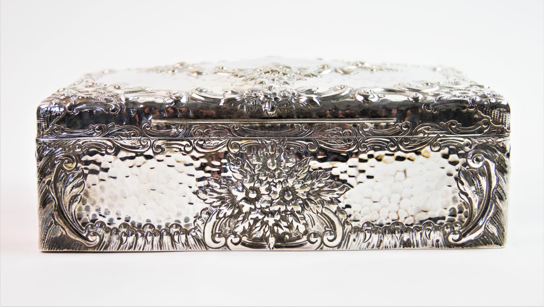 Lot 1 - An Edwardian silver cigar case of large proportions, Joseph Braham, London 1902, the rectangular