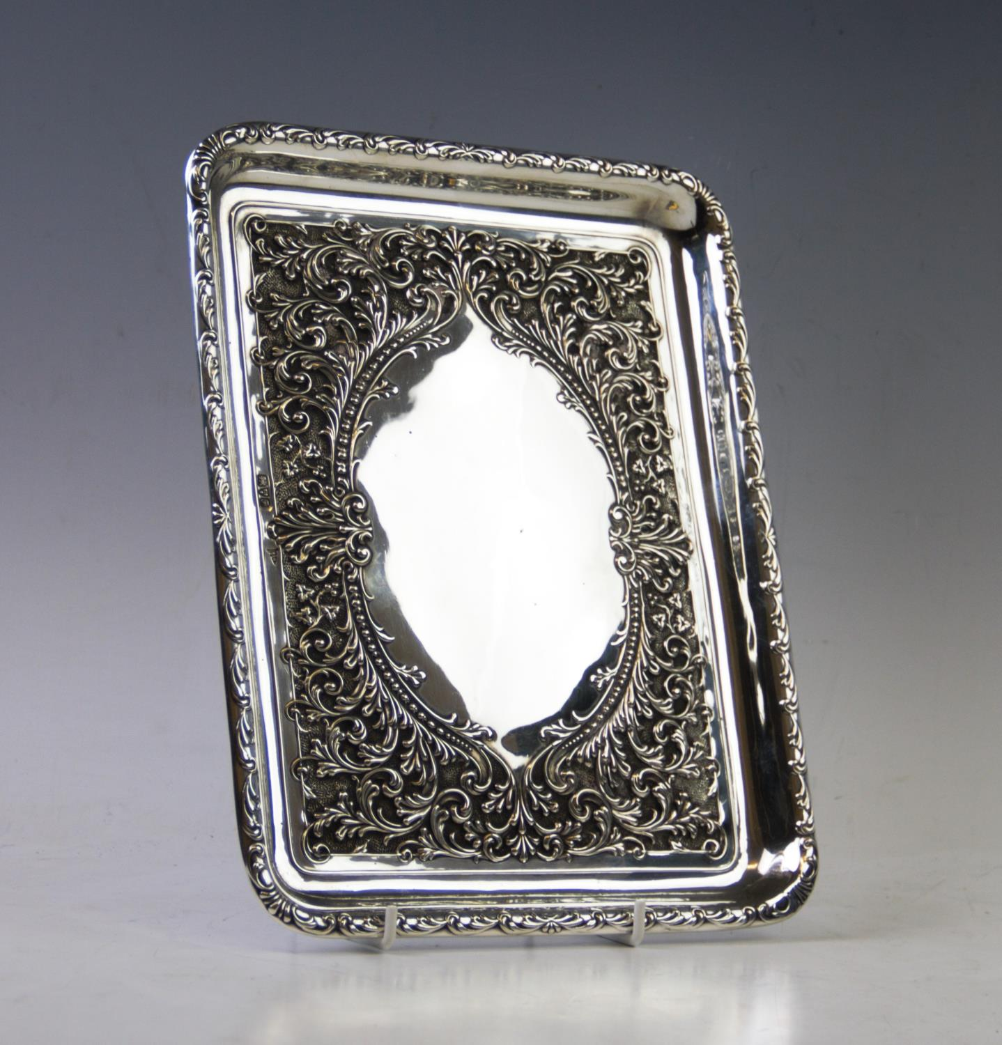Lot 7 - An Edwardian silver tray, Walker & Hall, Chester 1906, of rectangular form, the central vacant