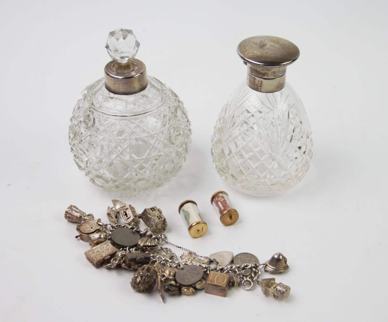 Lot 24 - A George VI silver topped scent bottle, Birmingham 1945, plain polished hinged top and cut glass