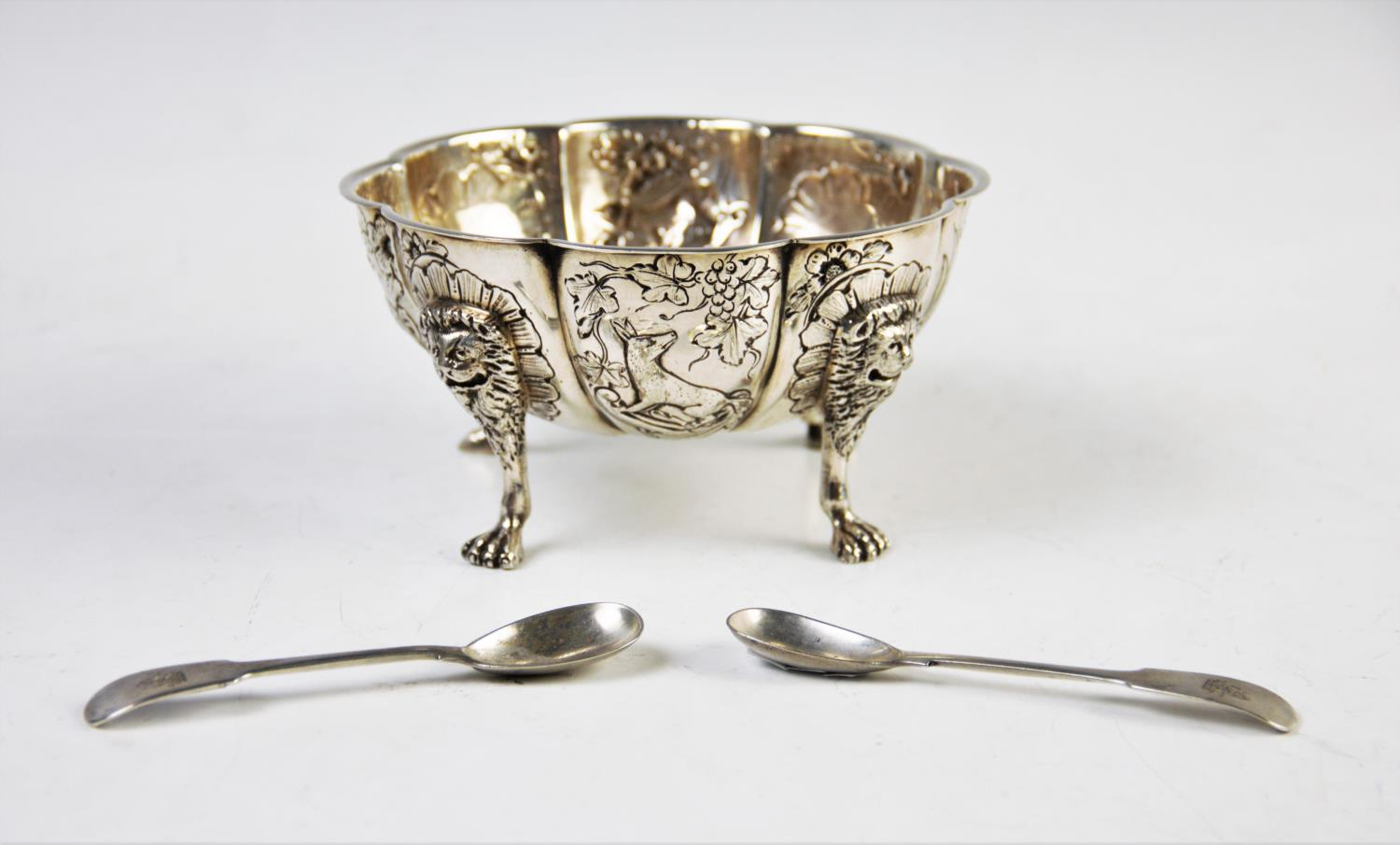 Lot 41 - A continental white metal bowl, the floral form bowl, with eight defined panels, decorated with a