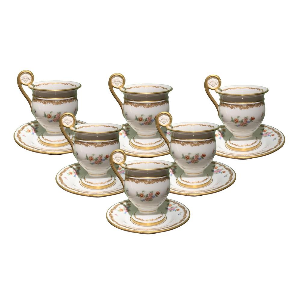 Lot 222 - SEI TAZZE da caffe' con piattini in porcellana Doccia bianca con decori a motivi floreale e