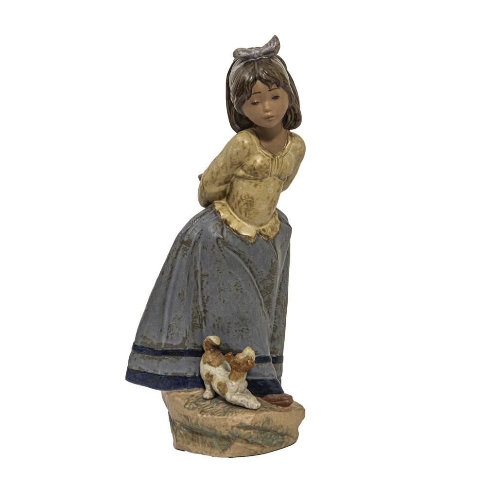 """Lot 611 - SCULTURA in porcellana Lladro policroma raffigurante """"Fanciulla con cane"""". XX secolo Misure: h cm"""