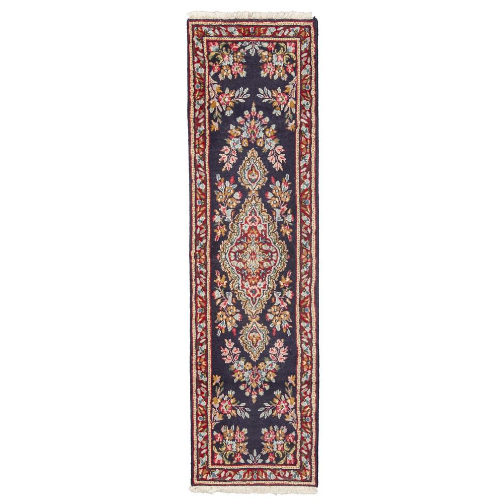 Lot 842 - TAPPETO Kerman, trama e ordito in cotone, vello in lana. Persia XX secolo Misure: cm 205 x 58,5