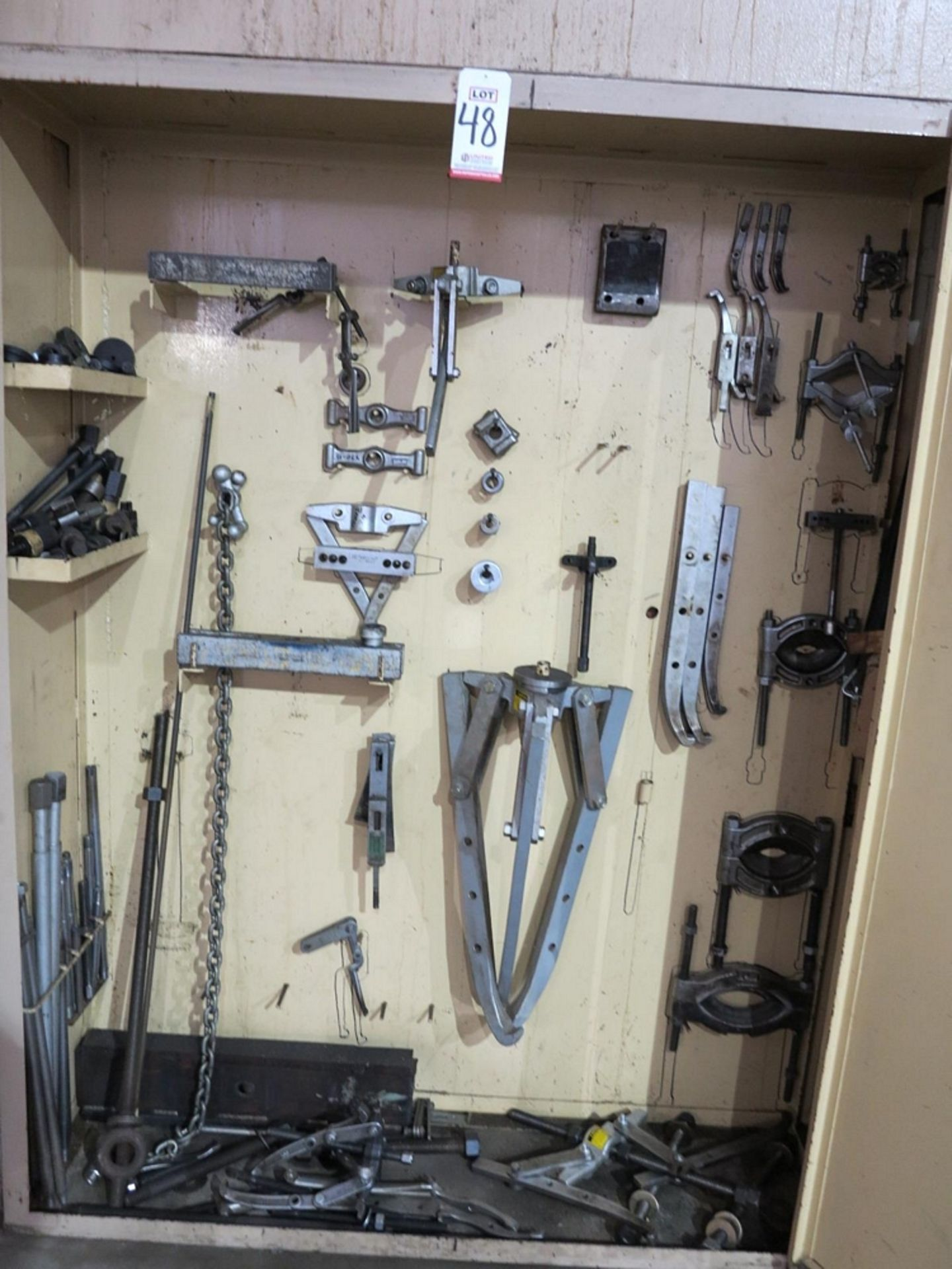 Lot 48 - LOT - CONTENTS OF 2-DOOR SECTION OF LARGE STEEL CABINET TO INCLUDE: LARGE QTY OF PULLERS