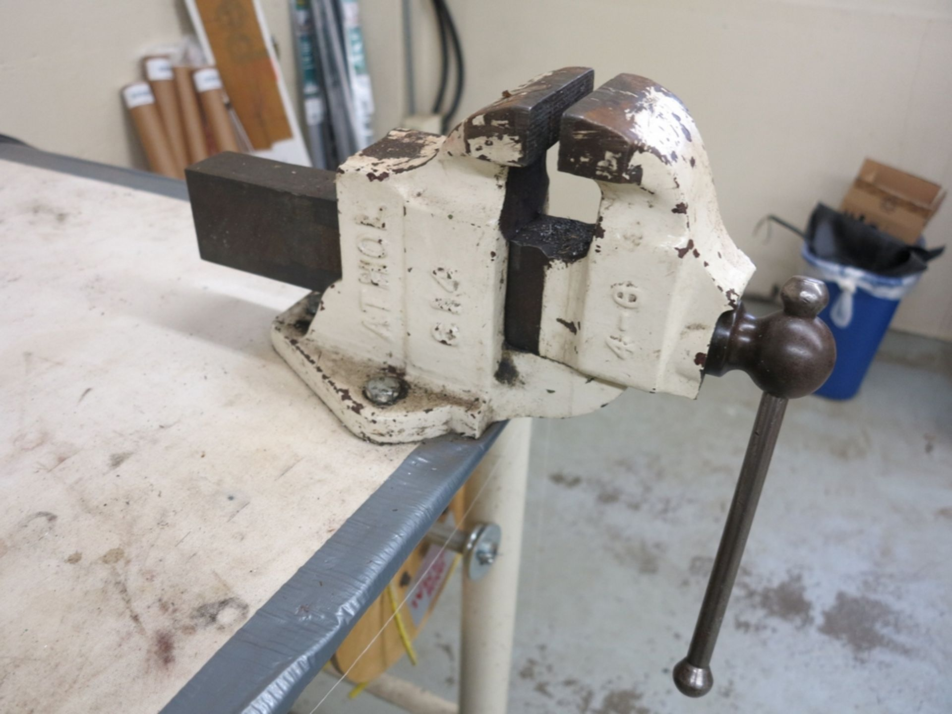 """Lot 36 - STEEL WORKBENCH, 6' X 4' X 34"""", W/ 4"""" ATHOL BENCH VISE, TOP IS 1/4"""" THICK"""