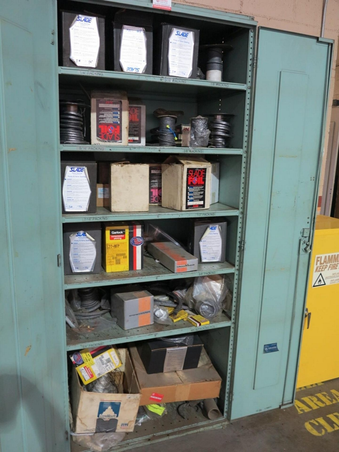 Lot 45 - 2-DOOR STORAGE CABINET W/ CONTENTS OF PUMP AND VALVE SEALING, COMPRESSION PACKING, ETC.