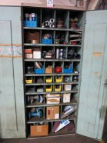Lot 25 - 2-DOOR STORAGE CABINET W/ CONTENTS OF PUMP PARTS, FLANGE KITS, PIPE SLEEVES, COUPLINGS, ABRASIVE