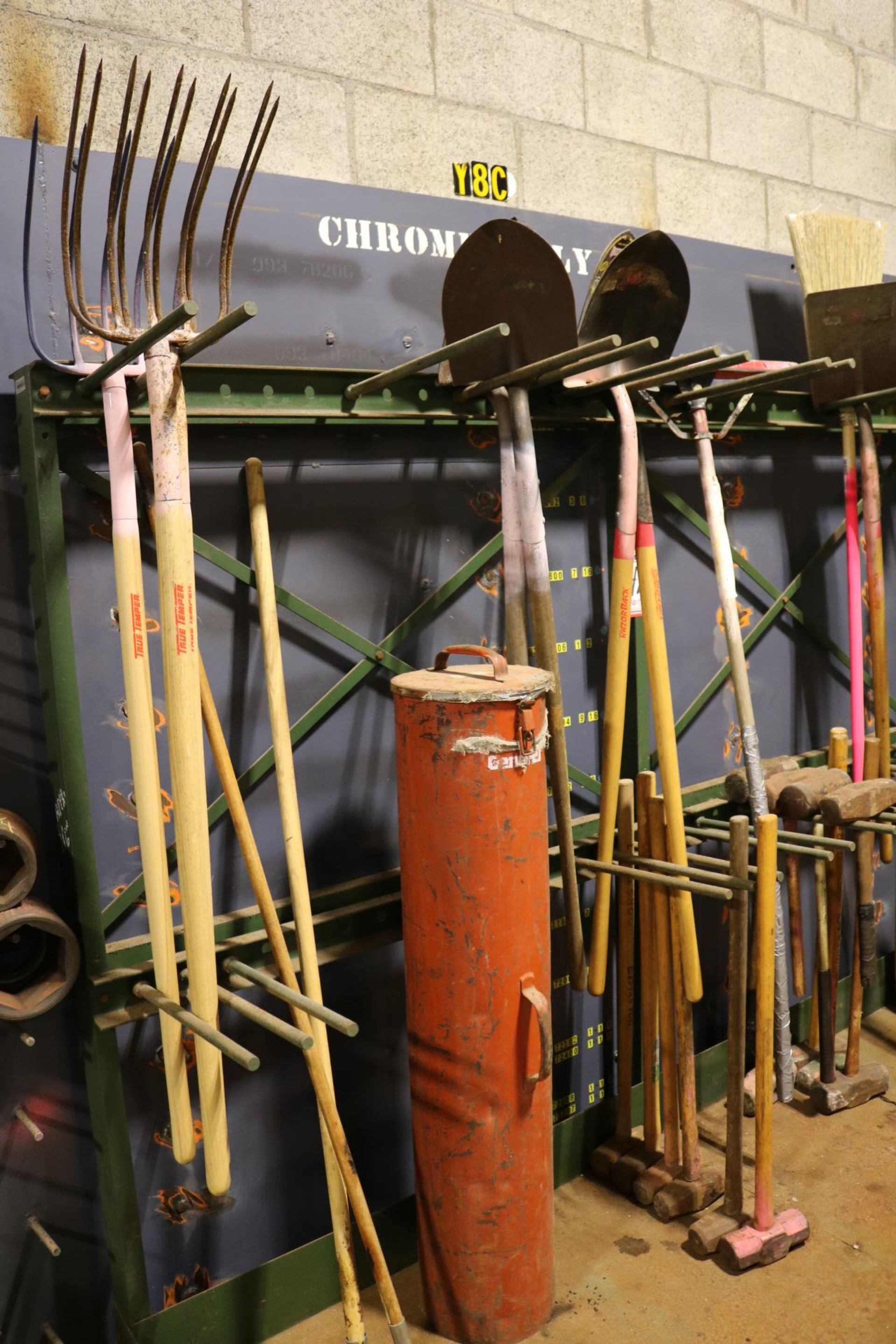 Lot 42 - LOT - STEEL LAWN IMPLEMENT RACK, W/ CONTENTS TO INCLUDE: PITCHFORKS, SHOVELS, POST HOLE DIGGERS,
