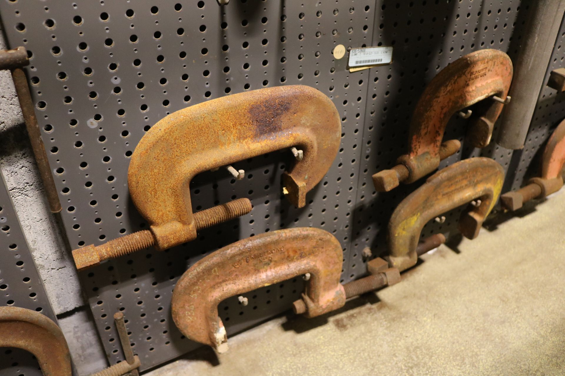 "Lot 9 - LOT - (1) SECTION OF STEEL PEG BOARD, 32"" X 84"", W/ CONTENTS: PIPE BENDERS, GREENLEE 650 6"" HOOK"